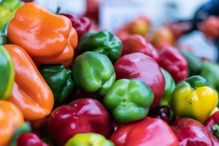 A bunch of multicolored sweet peppers sold on the market Stock Photo
