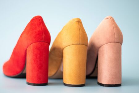 Multicolored shoes on high-heels back view on light background Standard-Bild