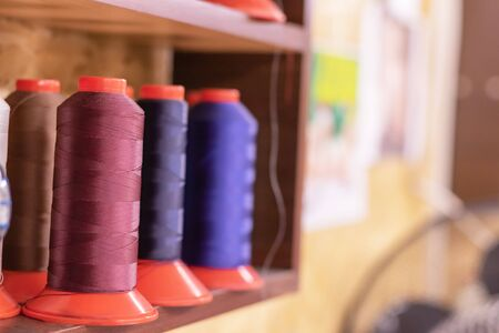 Colorful thread spools used in fabric and textile industry for shoes making