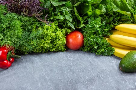 Healthy food background. Healthy food concept with fresh vegetables and ingredients for cooking. Top view with copy space. Dark background.