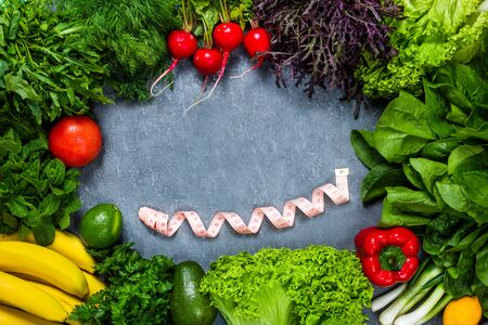 Healthy lifestyle diet concept picture of balanced nutrition with vegetables and fruits. Nutrition and diet picture with measuring tape 免版税图像