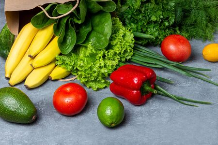Healthy food background. Healthy food concept with fresh vegetables and ingredients for cooking. Top view with copy space. Stone background.