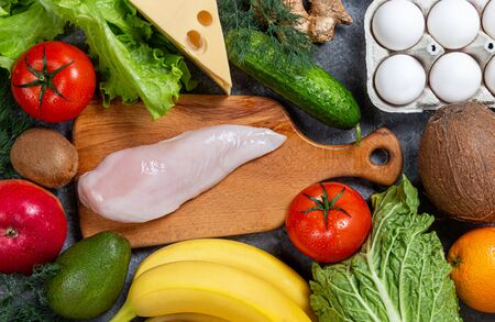 Conceptual image of a healthy food balance with vegetables fruits and meat nutrition and diet picture with copyspace 免版税图像