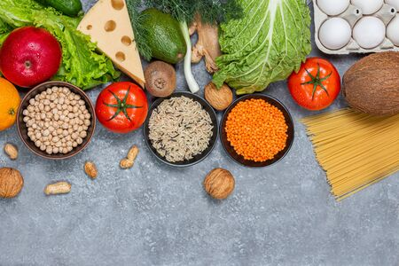 Conceptual image of a balance of healthy food with vegetables and fruits. Nutrition and diet picture with copyspace