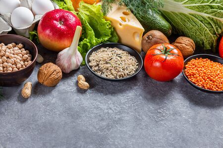 Conceptual image of a diet balance food with vegetables and fruits. Nutrition and diet picture with copyspace