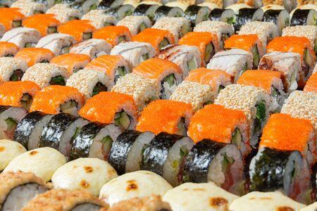 Overhead japanese sushi food. Maki ands rolls with tuna, salmon, shrimp, crab and avocado. Top view of assorted sushi, all you can eat menu. Rainbow sushi roll, uramaki, hosomaki and nigiri.