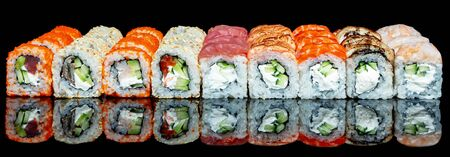 Poster with sushi rolls set isolated Philadelphia roll, california with fresh ingredients on black background. Sushi menu. Japanese food.