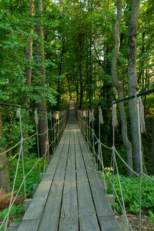 Suspension bridge, walkway to the adventurous, cross to the other side travel concept