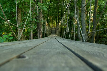 Suspension bridge, walkway to the adventurous, cross to the other side travel concept 免版税图像 - 149948584