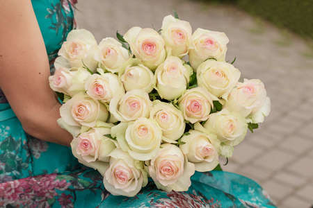 Big bouquet of yellow roses in woman hands