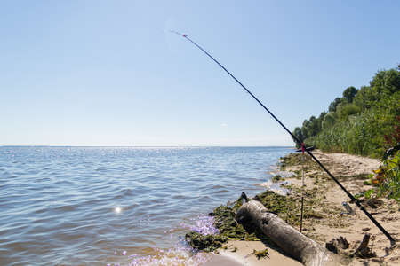 Fishing on the feeder on the seashore 免版税图像