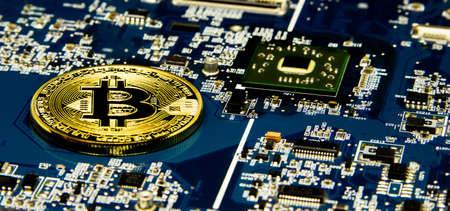 Bitcoin Mining Concept gold Bitcoin on the microchip board