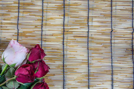 wood blinds: Roses placed on a woven wood blinds 5