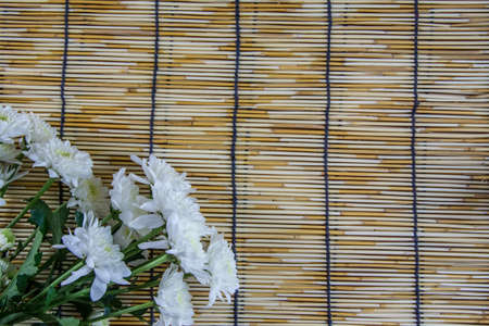 wood blinds: white Flowers placed on a woven wood blinds 1