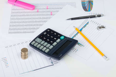 entries: Busy financial desktop with calculator, money, charts and highlighted ledger entries