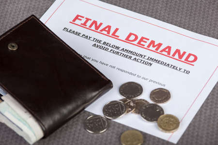 demand: Final demand laying on a table with some loose cash and wallet