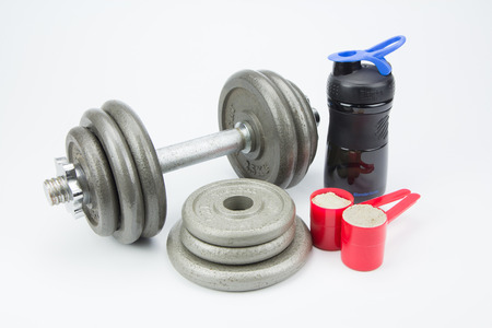whey: whey protein and dumbbell