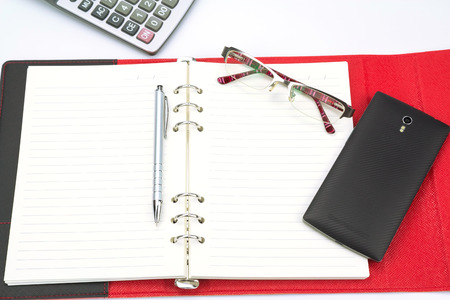 appointment book: Business concept.Mobile phone, calculator, glasses and pen