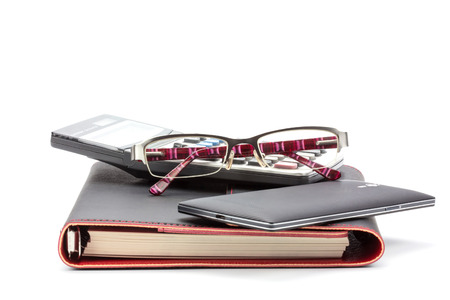 Business concept. Notebook, Calculator, Smart phone and Glasses photo