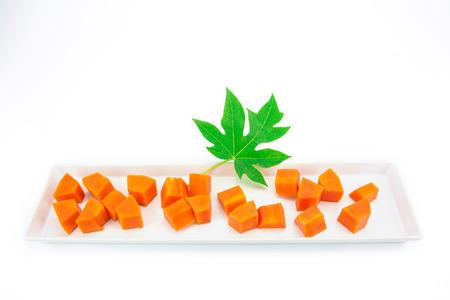 Sweet papaya slice on white ceramic dish bord isolated on white background Archivio Fotografico