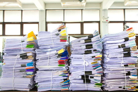 office chaos: Stack of business papers