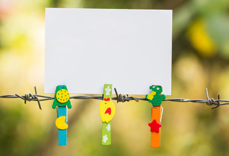 Photo Frames on barbed wire with colored clothespins photo