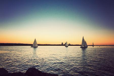 Sailing yacht against sunset,Vintage effect