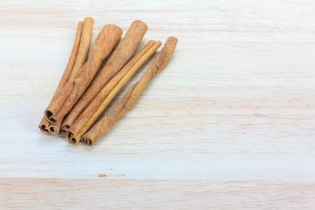 stick of cinnamon: Close up cinnamon stick on wooden background Stock Photo