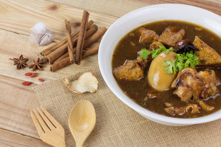 chitterlings: Pork and egg stewed in the gravy on wooden table