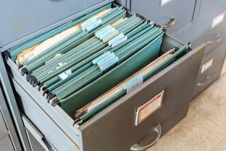 listing: File folders in a filing cabinet