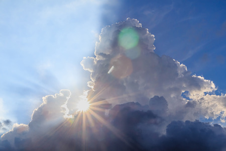 Beam of light and the clouds with sun flare Foto de archivo