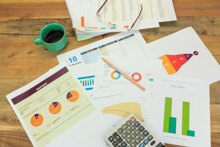 ideas risk: Business concept of a pencil, charts, eyeglasses, calculator, coffee cup