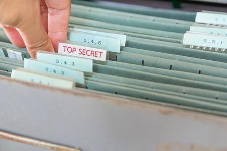 cloak and dagger: File folders in a filing cabinet