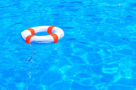Life buoy floating in a swimming pool Archivio Fotografico