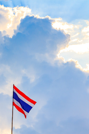 nation: Thai nation flag with blue sky background.