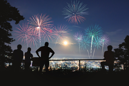 color of year: Silhouette of peoples enjoy watching firework show Stock Photo