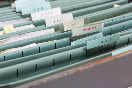 investigative: File folders in a filing cabinet