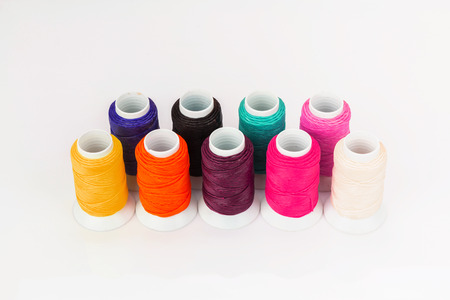 waxed: Colorful waxed cord isolated on white background Stock Photo