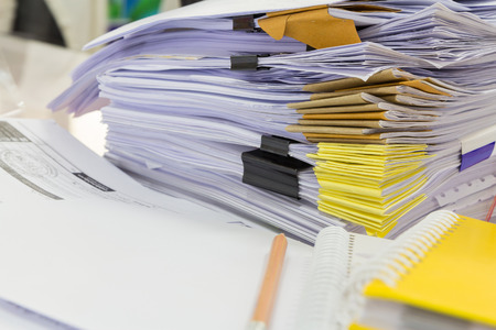 stack of papers: Stack of business papers on office desk