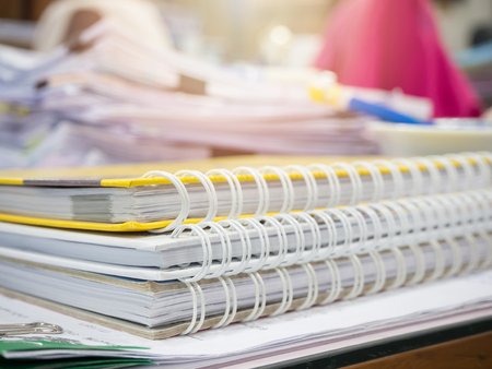 Messy office desk, Close up stack of notebook Stock Photo