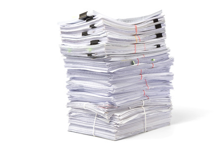 manage clutter: Stack of business papers isolated on white background Stock Photo