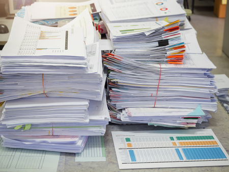 Business Concept, Pile of unfinished business documents on office desk, Stack of business paper Archivio Fotografico