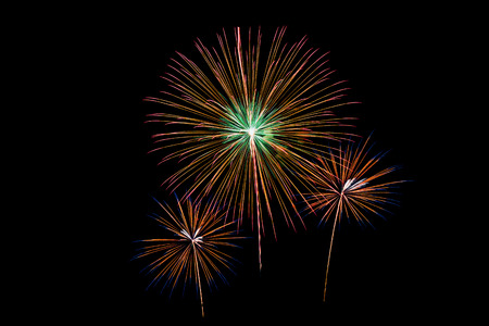 artifice: Colorful new year fireworks over dark sky