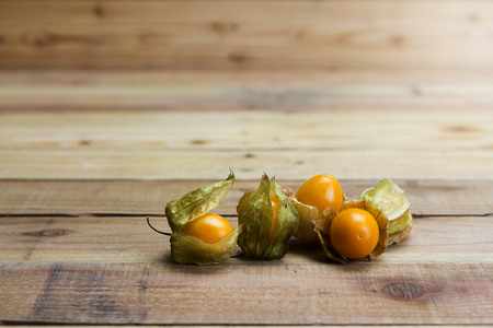 Closeup Cape gooseberry on wooden background