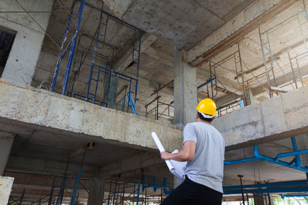 site: Construction concepts, Engineer and Architect working at Construction Site with blueprint