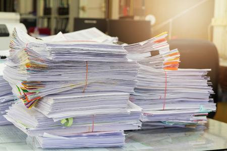 paper stack: Business Concept, Pile of unfinished documents on office desk, Stack of business paper