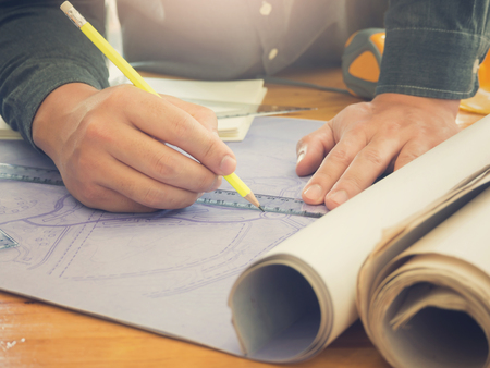 architect drawing: Architect concept, Architects working with blueprints in the office, Vintage Effect Stock Photo