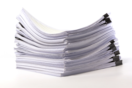 manage clutter: Stack of business papers on white background Stock Photo