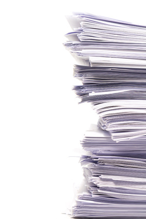 unorganized: Stack of business papers isolated on white background Stock Photo