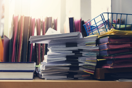 Business and finance concept of office working, Pile of unfinished documents on office desk, Stack of business paper